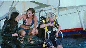 Preparing the dive... (nice latex suit btw)