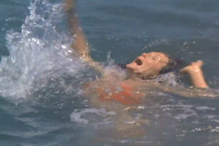 Female diver attacks female swimmer!